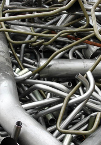 a pile of silver and olive-green metal waste giving a textured background