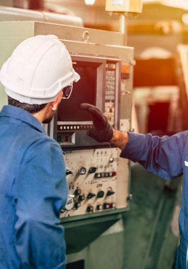 industry engineer team worker teaching help friend operate control heavy machine in factory